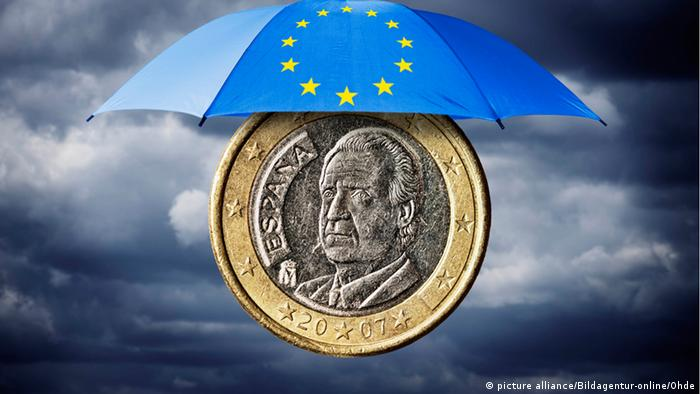 Spanish 1 euro coin, placed under an umbrella