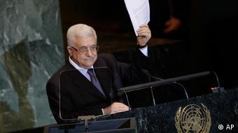Palestinian President Mahmoud Abbas holds a letter requesting recognition of Palestine as a state as he addresses the 66th session of the United Nations General Assembly, Friday, Sept. 23, 2011 at UN Headquarters. (AP Photo/Mary Altaffer)
