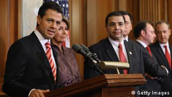 Mexican President-Elect Enrique Pena Nieto (L) delivers brief remarks after meeting with Democratic members of the House (Photo by Chip Somodevilla/Getty Images)
