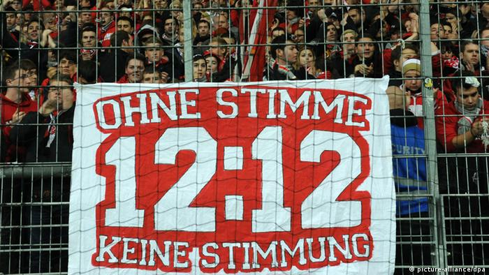 Fans of Mainz at their away game in Frankfurt this season hold a large 12:12 protest banner.