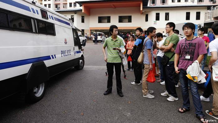 A police van reverses out of a dormitory as negotiations with striking bus drivers continued in Singapore on Monday, November 26, 2012. Photo: REUTERS/Edgar Su