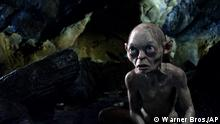 """FILE - This publicity file photo released by Warner Bros., shows the character Gollum voiced by Andy Serkis in a scene from the fantasy adventure The Hobbit: An Unexpected Journey. Dolby Laboratories Inc. and director Peter Jackson's Park Road Post Production announced Wednesday, Oct. 24, 2012 that The Hobbit: An Unexpected Journey will be mixed and released in Dolby Atmos. The first of three films in """"The Hobbit"""" series is slated to be released Dec. 14, 2012. (Foto:Warner Bros., File/AP/dapd)"""