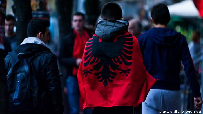 28, 2012 - In 1912, Albania became the last Balkan country to declare independence from the Ottoman Empire. But many Albanians were left outside the new state, giving rise to the dream of ''all Albanians under one nation.''..Streets of Tirana the ethnic Albanian capital city turned into red and black and people walking up and down the main streets as taking pictures, hugging each other with the best wishes of making their dream reality sooner or later as they say. .Tirana, Albania ââ¬â Wednesday, 28 November 2012