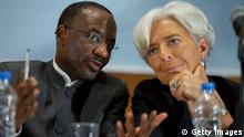 ABUJA, NIGERIA - DECEMBER 20: In this handout image provided by the International Monetary Fund (IMF), talks with Nigerian Central Bank Governor Sanusi Lamido Sanusi (L) during a joint press conference December 20, 2011 in Lagos, Nigeria. Lagarde is on her first trip to Africa as the Managing Director and will also visit Niger. (Photo by Stephen Jaffe/IMF via Getty Images)