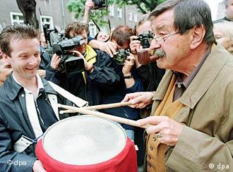 Grass beats a tin drum in front of his family home in Gdansk