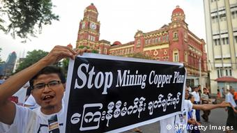 Protesters hold banners as they protest against Latpadaung copper mining plan in Yangon on November 26, 2012. The copper mine, a joint venture between military-owned Myanmar Economic Holdings and China's Wanbao company, has been the subject of controversy for months after local media allegations of corruption over the project. AFP PHOTO/ Soe Than WIN (Photo credit should read Soe Than WIN/AFP/Getty Images)