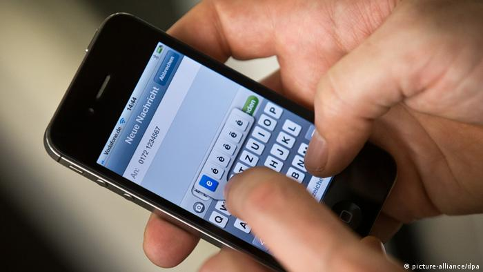 Male hands can be seen typing a text message