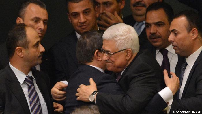 GettyImages 157166719 Palestinian Authority President Mahmoud Abbas (C) gets a hug from Ahmet Davutoglu, Turkey's Foreign Minister, as the Palestinians celebrate after the United Nations General Assembly voted to approve a resolution to upgrade the status of the Palestinian Authority to a nonmember observer state November 29, 2012 at UN headquarters in New York. AFP PHOTO/Stan HONDA (Photo credit should read STAN HONDA/AFP/Getty Images)