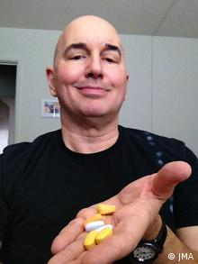 HIV Patient John-Manuel Andriote hold pills