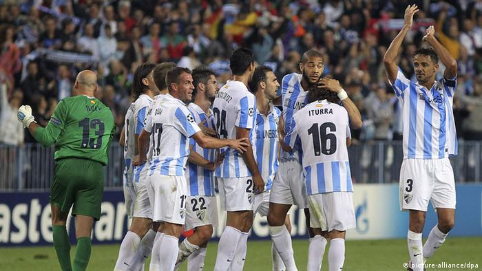 Spanish Malaga FC players celebrate after defeating Italian AC Milan, during their UEFA Champions League Group B soccer match at La Rosaleda stadium in Malaga, southern Spain, 24 October 2012. EFE/Daniel Perez