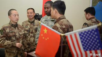 A US Army Pacific soldier, center, and Chinese People's Liberation Army (PLA) soldiers chat at a PLA facility in Chengdu in China's southwest Sichuan province Friday, Nov. 30, 2012. (Photo:Peter Parks, Pool/AP/dapd)