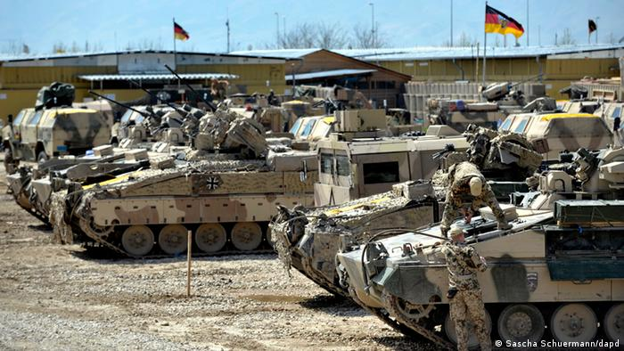 German tanks and soldiers at a military base in Kunduz, Afghanistan