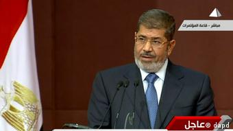 Image from a live broadcast on Egyptian State Television, Egyptian President Mohammed Morsi speaks to the constituent assembly in Cairo, Egypt, Saturday, Dec. 1, 2012. Photo: Egyptian State Television/AP/dapd