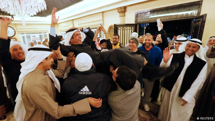 Newly-elected Member of Parliament Adel al Khorafi is carried by supporters, after final results of the election was announced, in Kuwait City (Photo: REUTERS/Jamal Saidi)