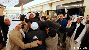 Newly-elected Member of Parliament Adel al Khorafi is carried by supporters(photo: REUTERS/Jamal Saidi)