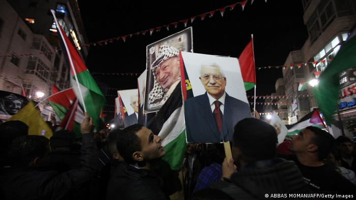 Palestinians celebrate in the West Bank city of Ramallah (Photo: ABBAS MOMANI/AFP/Getty Images)