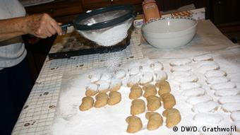Preparing Greek pasties called kourambiedes (c) Daphne Grathwohl