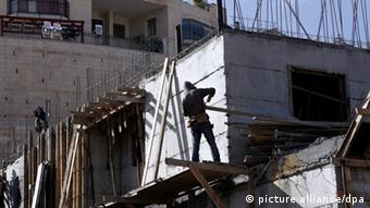 A Palestinian at a building site in an East Jerusalem neighborhood (Photo: Jim Hollander)