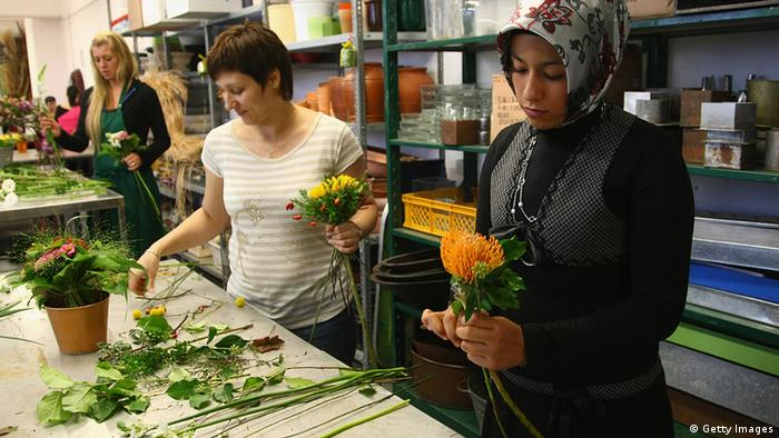Young women training to become florists, including a Muslim woman wearing a headscarf. (Photo: Sean Gallup/Getty Images)