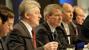 CEO Heinrich Hiesinger of ThyssenKrupp, second left, talks to the media besides CEO Mika Seitovirta of Outokumpu, center, at a press conference in Duesseldorf, Germany, Wednesday, Feb. 1, 2012. (Photo via AP/dapd)