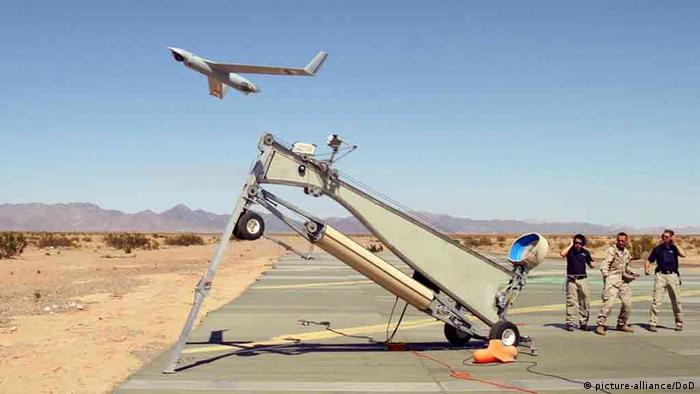 US Marine Corps Sgt. Michael Kropiewnicki, a combat videographer assigned to 2nd Marine Aircraft Wing Combat Camera, launches a Boeing ScanEagle Unmanned Aerial Vehicle during the training exercise Desert Talon 2-06 onboard Marine Corps Air Station. (Photo: Newscom)