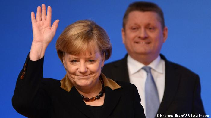 German Chancellor Angela Merkel waves as she arrives with CDU Secretary General Hermann Groehe to open a congress of their ruling conservative Christian Democratic Union (CDU) party on December 4, 2012 in Hanover, central Germany. Germany's Angela Merkel will rally the rank-and-file of her conservative party at its annual congress running until December 5, eyeing a third term as chancellor of Europe's top economy in elections in the year 2013. AFP HOTO / JOHANNES EISELE (Photo credit should read JOHANNES EISELE/AFP/Getty Images)