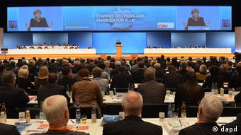 Delegates listening to Merkel's speech at the CDU party meeting
