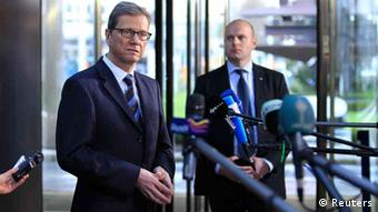German Foreign Minister Guido Westerwelle speaks to reporters while arriving at a two-day NATO foreign ministers at the Alliance's headquarters in Brussels December 4, 2012. NATO foreign ministers will agree on Tuesday to send Patriot missiles to beef up Turkey's air defenses and calm Turkey's fears that it could come under missile attack, possibly with chemical weapons, from Syria, diplomats said. REUTERS/Yves Herman (BELGIUM - Tags: MILITARY POLITICS)