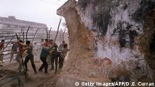 December 6, 1992 In this December 6, 1992 photograph, Indian Hindu fundamentalists attack the wall of the 16th century Babri Masjid Mosque with iron rods at a disputed holy site in the city of Ayodhya. An Indian court ruled September 30, 2010 that a disputed holy site in Ayodhya with a history of triggering Hindu-Muslim clashes should be divided -- a judgement seem as favouring the Hindu litigants. In 1992, the demolition of the 16th-century Babri Mosque in Ayodhya by Hindu activists sparked riots that killed more than 2,000 people, mostly Muslims, and propelled India's Hindu nationalists into the political mainstream. AFP PHOTO/DOUGLAS E CURRAN/FILES (c)