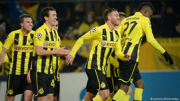 Dortmund's Julian Schieber (C) celebrates with his teammates Kevin Grosskreutz, Ivan Peresic and Felipe Santana after scoring the 1:0 during the UEFA Champions League group D soccer match between Borussia Dortmund and Manchester City at BVB stadium in Dortmund, Germany, 04 December 2012. Photo: Bernd Thissen/dpa