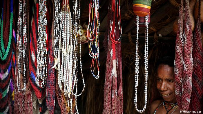 A woman of the traditional, Dani tribe from Lembah Baliem stands by bead necklaces and traditional bags on October 10, 2009 in Wamena, West Papua, Indonesia. (Photo: Ulet Ifansasti)