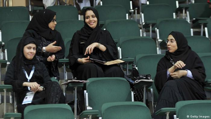 Saudi female journalists attend a men's Asian Handball Championship match between Saudi Arabia and Qatar in Jeddah on January 31, 2012. Female journalists were recently allowed to cover sporting events despite strict segregation of the sexes outside the home that is enforced by the kingdom's powerful religious police which means that women are effectively barred from many jobs and social activities. AFP PHOTO/Amer HILABI (Photo credit should read AMER HILABI/AFP/Getty Images)