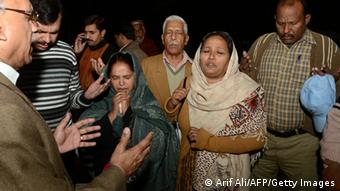 Pakistani Christian charity workers pray for the early recovery of charity worker Bargeeta Almby who was injured in an attack by gunmen in Lahore on December 3, 2012 (Photo: Arif Ali/AFP/Getty Images)