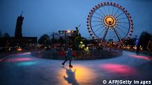 GettyImages 157076274 A girl ice-skates at a Christmas market near the Rotes Rathaus in Berlin on November 28, 2012. AFP PHOTO / JOHANNES EISELE (Photo credit should read JOHANNES EISELE/AFP/Getty Images)