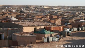 Photo: Aerial view of tents and houses.