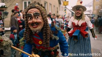 Photo of a masked figure at Austria's carnival parade, 'Schemenlaufen,' which is already protected as an intangible cultural heritage