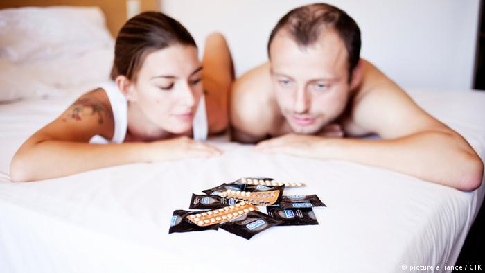 Young woman and young man with contraceptive pills, birth-control pill, condom, blister pack of combined oral contraceptive pills, birth control, prevention of pregnancy. (CTK Photo/Josef Horazny, Martin Sterba)