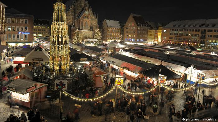 Christmas market in Nuremberg at night with all the festive lights on.