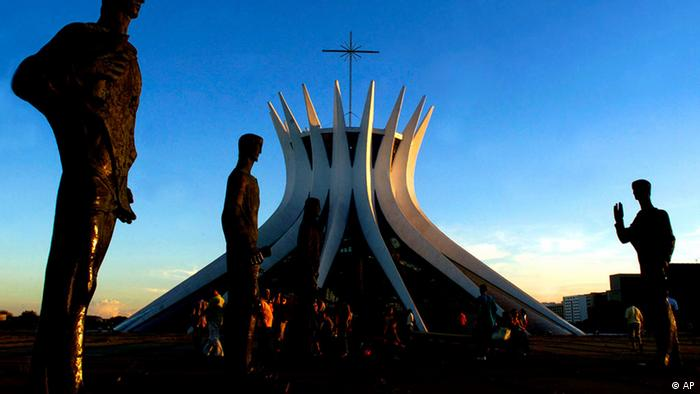 Statues of the apostles are seen in front of the Cathedral of Brasilia