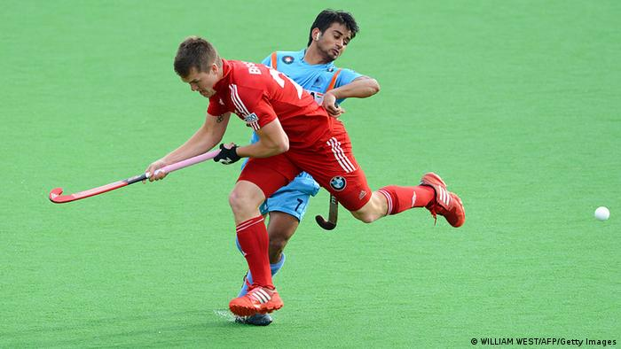 Manpreet Singh of India (R) is tackled by Tom Boon of Belgium (L) in their Men's Hockey Champions Trophy match in Melbourne on December 6, 2012 (Photo: WILLIAM WEST/AFP/Getty Images)