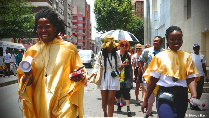 Tour guides lead the group along a Johannesburg street, Photo: Aya Bach