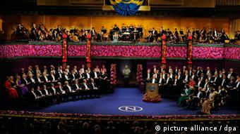 epa02488864 Overhead view of the Nobel prize ceremony at the Concert Hall in Stockholm, Sweden, 10 December 2010. Laureates are seated in front to the left and the royal family in front to the right. EPA/CLAUDIO BRESCIANI / SCANPIX / POOL ** SWEDEN OUT **