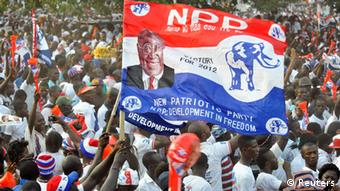 Supporters of Akufo-Addo waving the party's red, white and blue flag