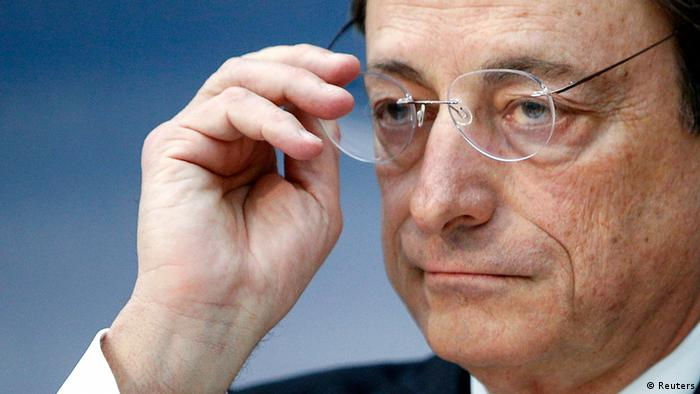 European Central Bank (ECB) President Mario Draghi takes off his glasses during the monthly ECB news conference in Frankfurt December 6, 2012. REUTERS/Lisi Niesner (GERMANY - Tags: BUSINESS)