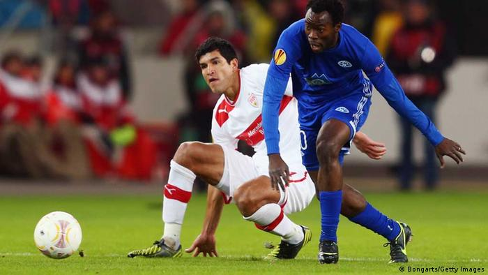 STUTTGART, GERMANY - DECEMBER 06: Davy Claude Angan (R) of Molde is challenged by Francisco Rodriguez Maza of Stuttgart during the UEFA Europa League group E match between VfB Stuttgart and Molde FK at Mercedes-Benz Arena on December 6, 2012 in Stuttgart, Germany. (Photo by Alex Grimm/Bongarts/Getty Images)