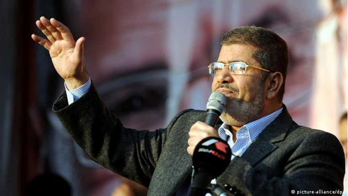 Egyptian President Mohamed Morsi speaks to his supporters outside the presidential palace al-Ethadeya, where tens of thousands of Egyptians rally to support Morsi's new constitutional declaration issued in Cairo, Egypt, on November 23, 2012