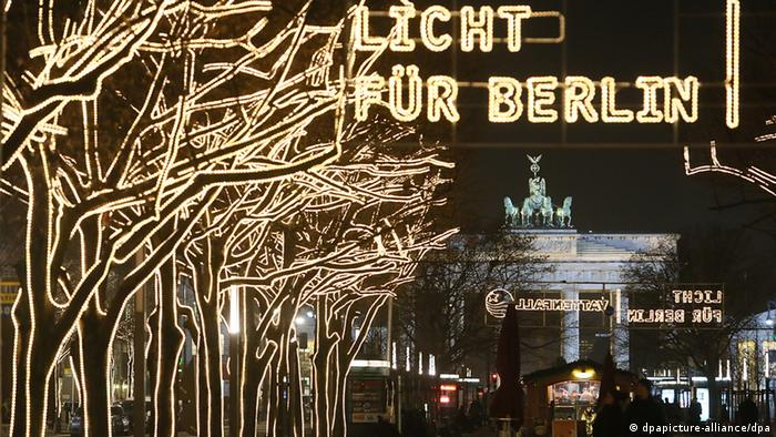 Christmas lights attached to the trees along the street Unter den Linden in Berlin