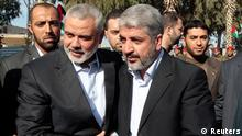 Hamas chief Khaled Meshaal (front R) walks with senior Hamas leader Ismail Haniyeh (front L) upon his arrival at the Rafah crossing in the southern Gaza Strip December 7, 2012. Meshaal arrived in the Gaza Strip on Friday, ending 45 years of exile from Palestinian land with a visit that underscored the Islamist group's growing confidence following a recent conflict with Israel. REUTERS/Ahmed Jadallah (GAZA - Tags: POLITICS)