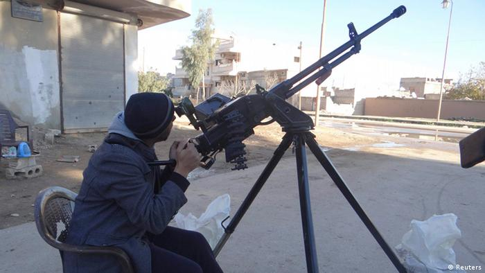 A Free Syrian Army fighter aims a weapon in the town of Ras al-Ain, near the province of Hasaka, 600 km (373 miles) from Damascus, December 5, 2012. Picture taken December 5. (photo: REUTERS/Samer Abdullah/Shaam News Network/Handout)