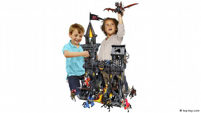 Girl and boy play with plastic castle and knights